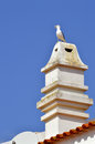 Typical portuguese chimney pot a with a seagull on top Royalty Free Stock Photos