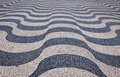 Typical portuguese cobblestone pavement on the street of Lisbon Royalty Free Stock Photo