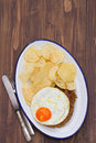 Typical portuguese sausage alheira with fried egg and potato on dish Royalty Free Stock Photo