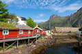 Typical red rorbu fishing hut in town of Svolvaer Royalty Free Stock Photo