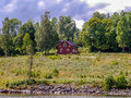 Typical red wood house on a lake in Sweden Royalty Free Stock Photo