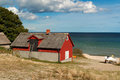 Typical red wooden house at Baltic Sea Stock Photos