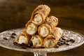 Typical sicilian pastries called cannoli with amarena listed in pastry on the plate Royalty Free Stock Photo