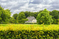 Typical Small Danish House In Green Park With Cloudscape in Back Royalty Free Stock Photo