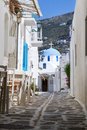 Typical small street in greece classical narrow with a painted sidewalk parikia Royalty Free Stock Photo