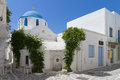 Typical small street in greece classical with a painted sidewalk parikia Royalty Free Stock Photography