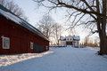 Typical swedish farm house in a wintry landscape Royalty Free Stock Photos
