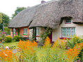 Typical thatched roof cottage in Ireland Royalty Free Stock Photo