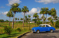 Typical view of classic blue american car on cuba where old vehicles become iconic part landscape after revolution Stock Photos