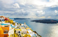 Typical view to the sea and volcano from fira the capital of santorini beautiful caldera greek houses built on cliff at with Royalty Free Stock Image