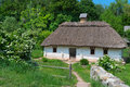 Typical village house in ukrainian countryside with gardens around Royalty Free Stock Photo
