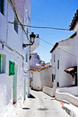 Typical white andalusian village street in in malaga Royalty Free Stock Photos