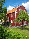 Typical wooden red house linkoping sweden swedish with a garden Royalty Free Stock Images