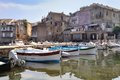 Typically small port corsica boats and houses facades faded into a in Royalty Free Stock Photos