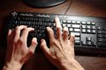 Typing on keyboard first person look Stock Photography