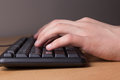 Typing male hands pc keyboard Stock Photos