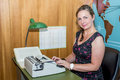 Typist secretary in a sixties style office with old typewriter Royalty Free Stock Photo