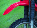 Tyre of motocross bike on grass on background selective focus on the middle part Royalty Free Stock Images