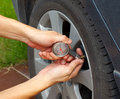 Tyre pressure guage measurement Royalty Free Stock Photos