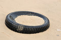 Tyre on the sand beach Royalty Free Stock Image