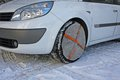 Tyres by car instead of socks to use snow chains for running saf Stock Photos