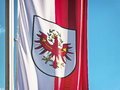 Tyrol flag of in front of blue sky Royalty Free Stock Photography