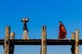 U bein teakwood bridge amarapura in myanmar burmar burmese merchant and monk at ancient Stock Photos