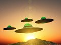 U f o ufo formation flying over mountains on sunset Royalty Free Stock Image