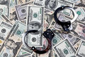 U.S. dollars bank notes and handcuffs. Royalty Free Stock Images