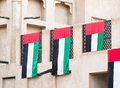 UAE flags on traditional house Royalty Free Stock Photo