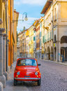 Udine - March 2016, Italy: Vintage Fiat 500 parked on the street of the old Italian city of Udine Royalty Free Stock Photo
