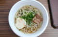 Udon noodles a bowl of with scallions and pork belly and fish cake Royalty Free Stock Images
