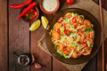 Udon pasta with shrimp, tomatoes and paprika. Royalty Free Stock Photo