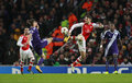 Uefa champions league arsenal v anderlecht london england nov maxime colin of and s aaron ramsey clash during the match between Royalty Free Stock Image