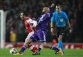 Uefa champions league arsenal v anderlecht london england nov nathan kabasele of fouls s santi cazorla during the match between Stock Images