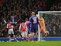 Uefa champions league arsenal v anderlecht london england nov s wojciech szczesny makes a save as aleksandar mitrovic of fouls s Stock Images