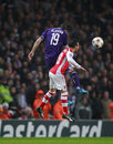 Uefa champions league arsenal v anderlecht london england nov sacha kljestan of and s santi cazorla compete for the ball during Stock Photo