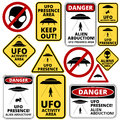 Ufo ships humorous danger road signs for aliens abduction theme vector illustration Stock Images