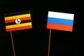 Uganda flag with Russian flag  on black Royalty Free Stock Photo