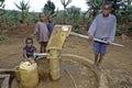 Ugandan children fetch water at water pump uganda luweero district village kirumba kyazanga group portrait of kids boys and girls Stock Photography