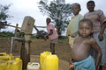 Ugandan Children fetching water at water pump Royalty Free Stock Photo