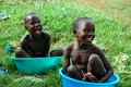 Ugandan children laugh in colorful bath basins gulu uganda africa circa may two unidentified take baths while laughing outside Royalty Free Stock Photos