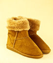 Ugg boots pair of brown with fleece lining studio background Royalty Free Stock Images