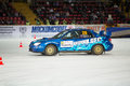 Uher and Afonin in racing car on ice Royalty Free Stock Photo