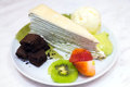 Uji matcha crepes cake with vanilla ice cram brownies and fruits topping Royalty Free Stock Photos