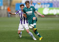 Ujpest vs gyori eto otp bank league football match budapest may tarmo kink of gyor overtakes krisztian simon of l during at Royalty Free Stock Image