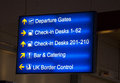 Uk airport sign signs to show different locations at the Royalty Free Stock Photos