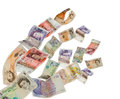 Uk currency shot as if flying away Stock Photo