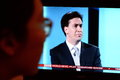 Uk election tv debate a viewer watches labour party leader ed miliband on a live streaming over the internet and broadcast on on Royalty Free Stock Photography