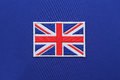 Uk flag patch on fabric Royalty Free Stock Photo